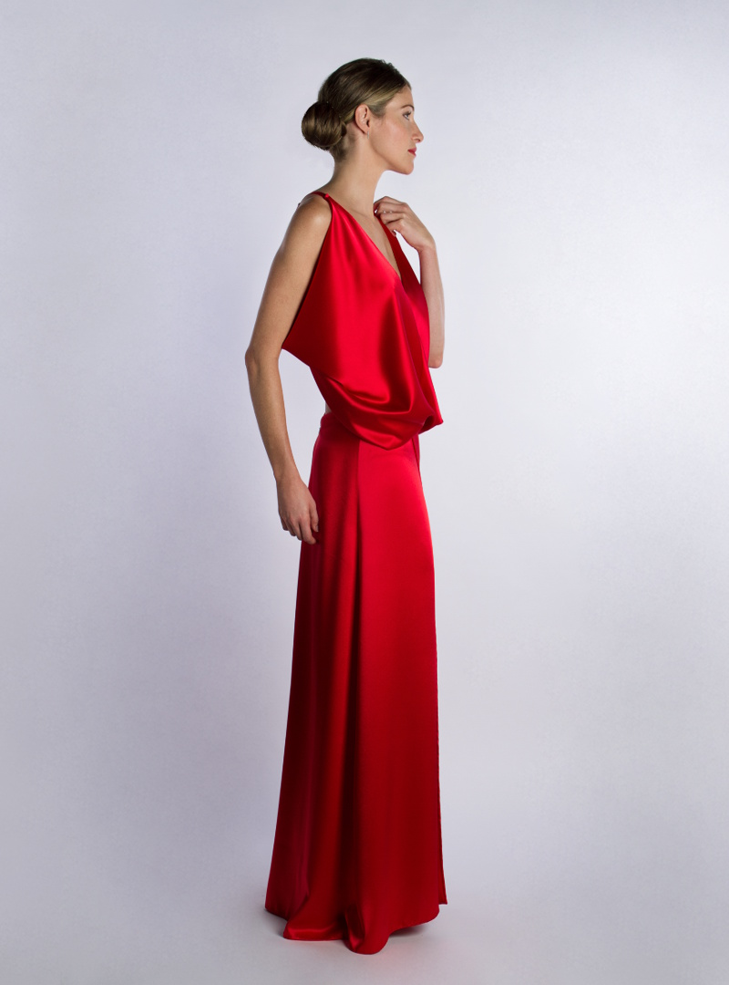 Ariel is a party dress from CRISTINA SAURA. It is made in satin crepe of red silk among other colors.