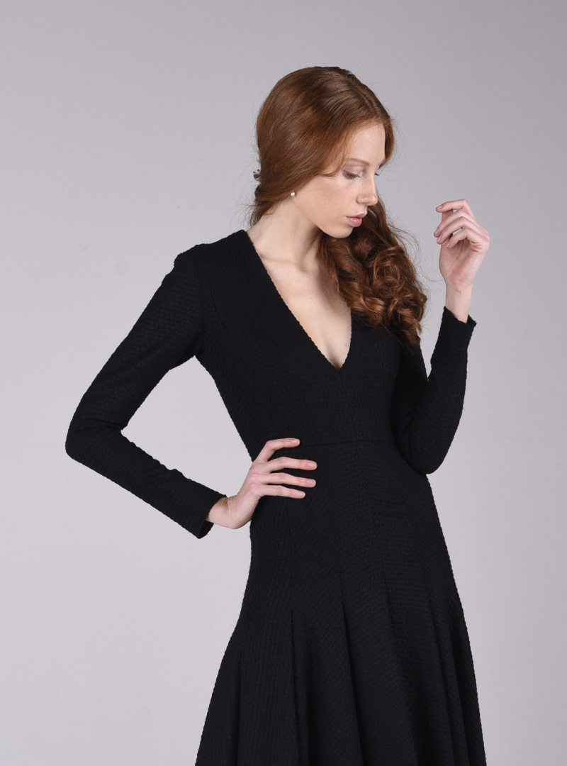 The body of the party dress, which is of classic cut, outlines in detail the female figure