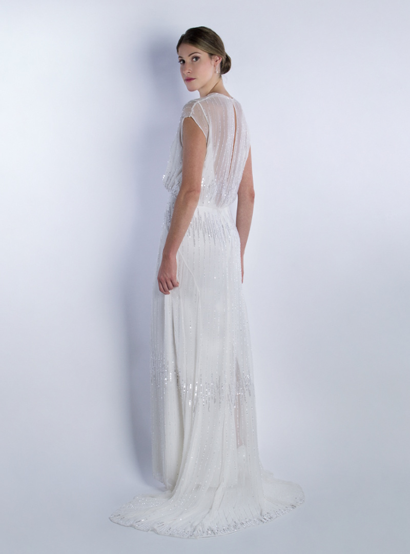 Subtle and elegant design for wedding dress of CRISTINA SAURA. Handmade piece in its entirety.