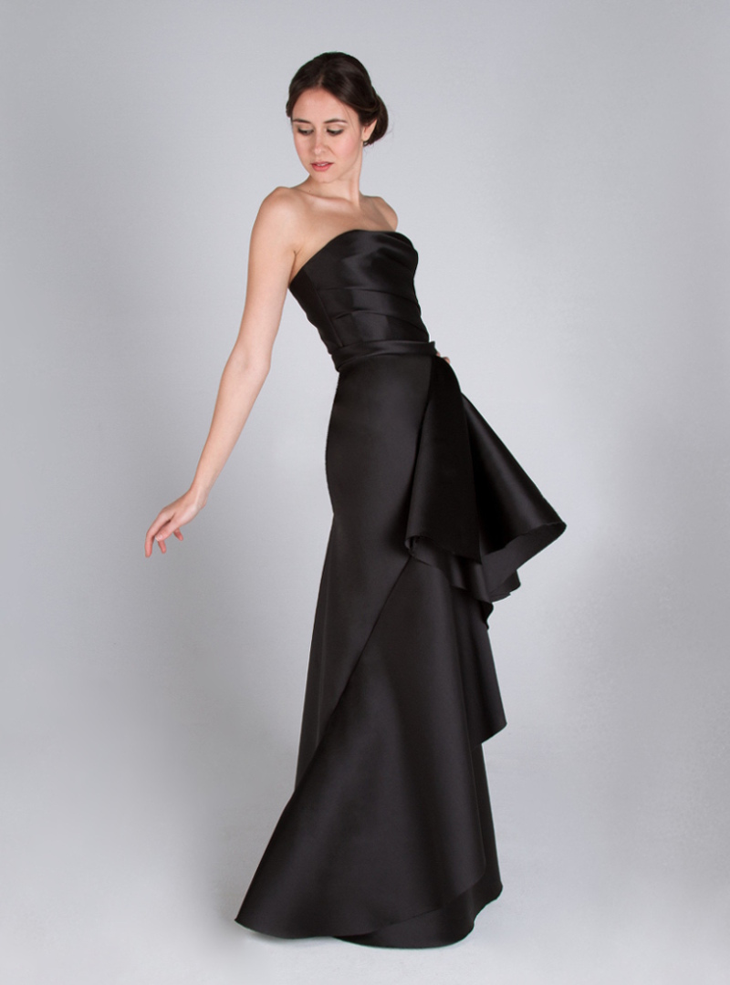 Evening dress designed by CRISTINA SAURA. It consists of draped on her neckline word of honor and bias skirt with fantasy.